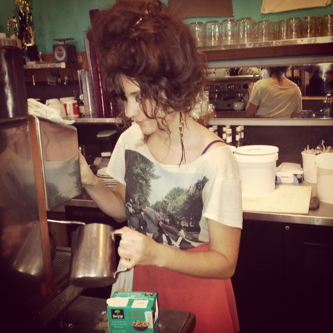 My fabulously coiffed barista Kelos. Marie Antoinette, hippie style. She just lived in her van for a month, + still ate vegan.  Sentient Bean. Savannah, GA