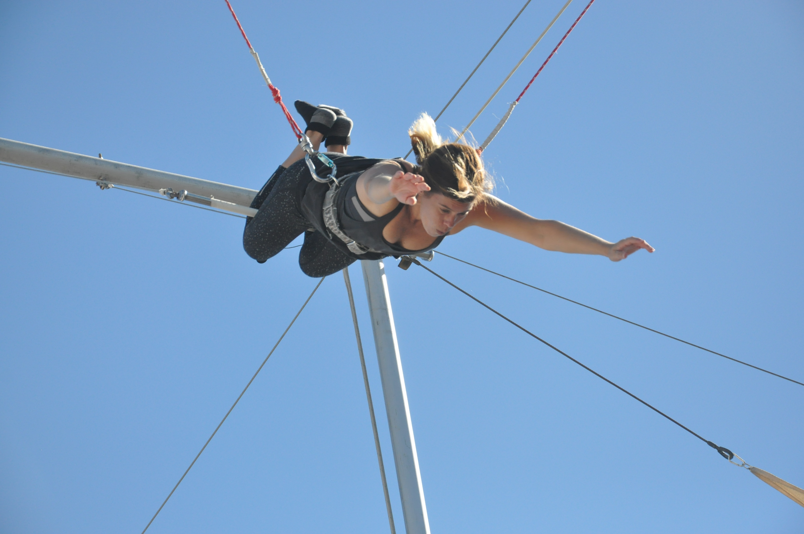 Entrepreneur Tiffany Scott about to make the catch on the flying trapeze! Trapeze School November 2015 Santa Monica, CA